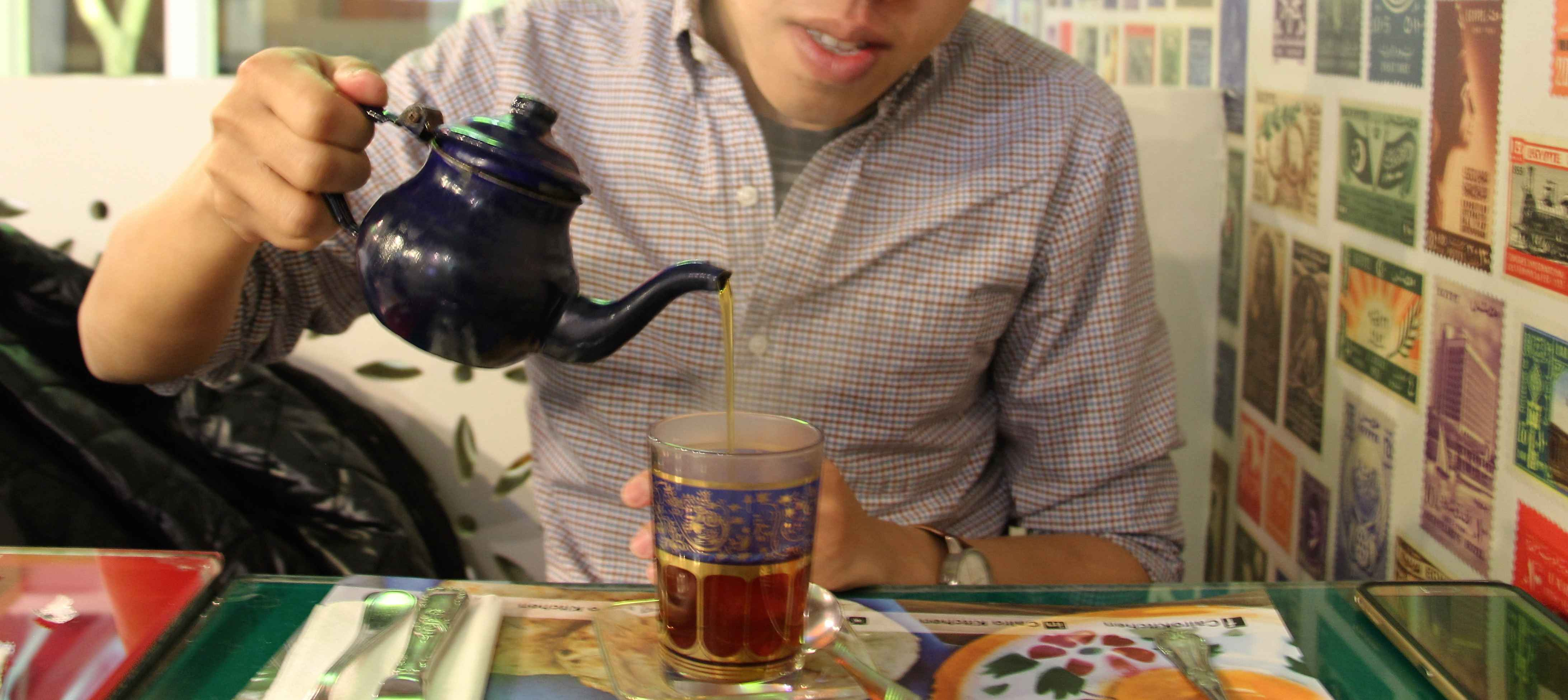 Pouring tea cairo kitchen