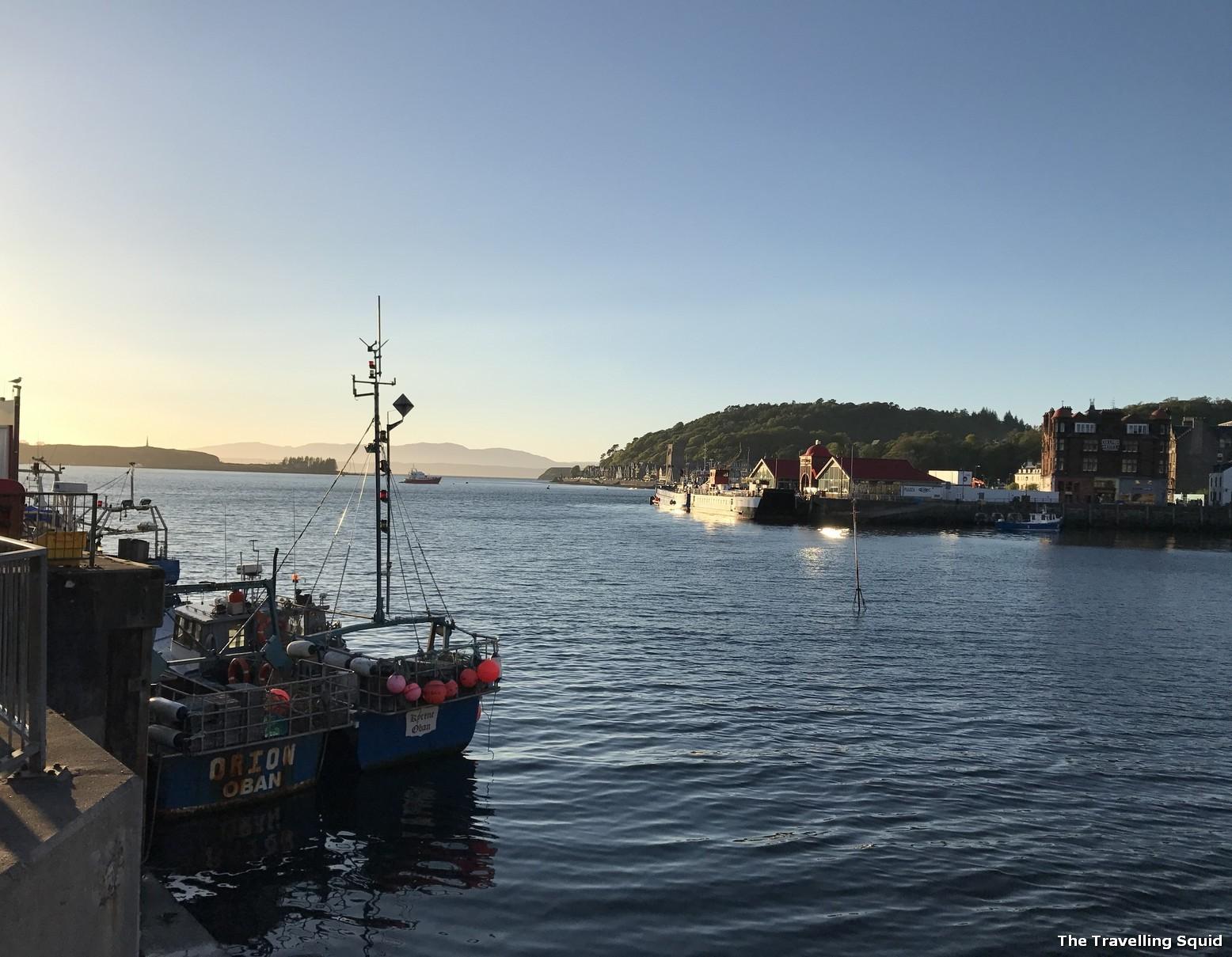 sunset oban seaside town