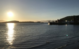 sunset oban seaside town