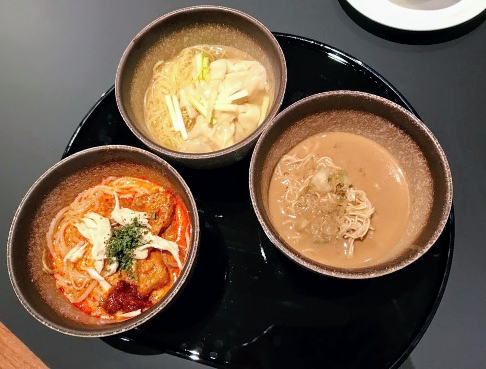 Clockwise from top: Wanton noodles, dan-dan noodles, laksa