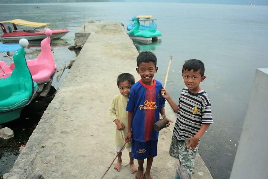 Lake Toba Sumatra kids fishing
