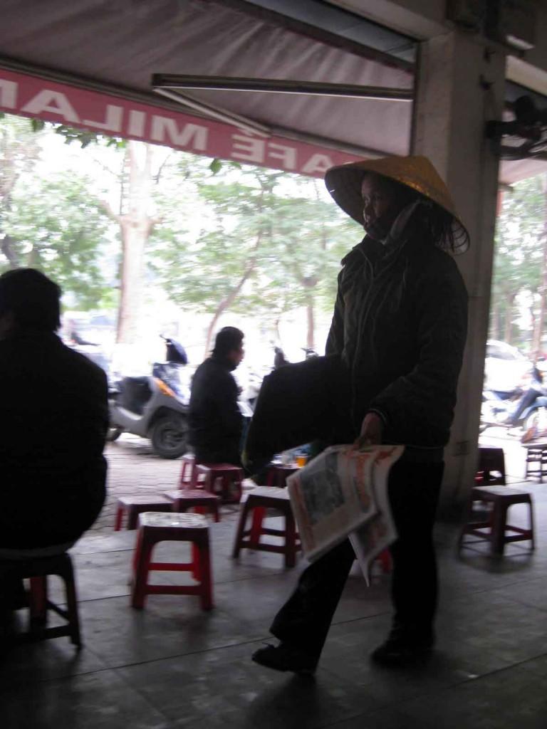 vietnam newspapers cafe hanoi