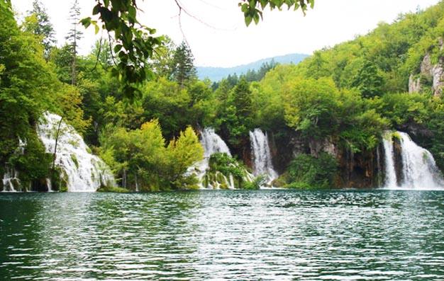 plitvice lakes gushing waterfalls