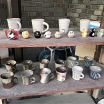 Buying wabi-sabi cups from a handmade pottery shop in Uji