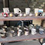 Buying wabi-sabi cups from a handmade pottery shop in Uji