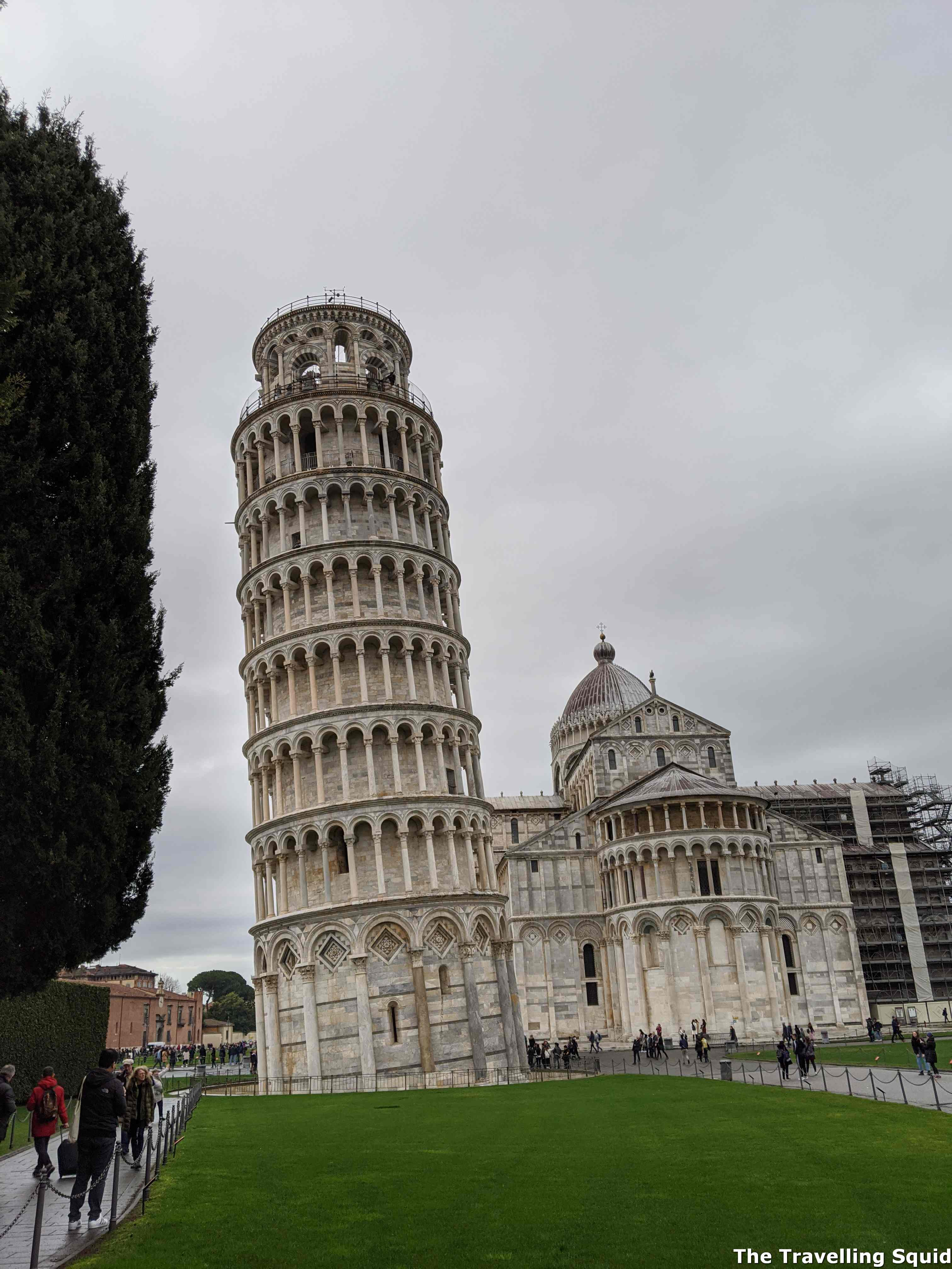 paying to climb up the Leaning Tower of Pisa